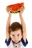 Boy holding a watermelon on head Stock Image