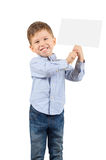 Boy holding a white blank card. Portrait of happy cute little boy holding a white blank card isolated on white background Royalty Free Stock Photography