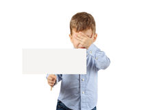 Boy holding a white blank card. Portrait of little boy holding a white blank card and closing eyes with hand isolated on white background Stock Photography