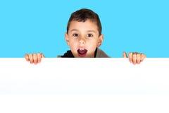 Boy holding white board Royalty Free Stock Image