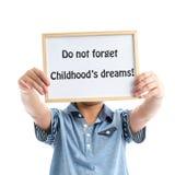 Boy holding whiteboard on white background Stock Photos