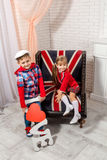 Boy holding the word love and girl sitting on chair Royalty Free Stock Image