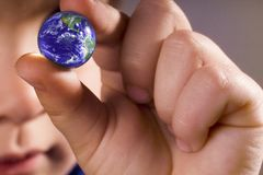 Boy holding the world. Children holding the earth globe royalty free stock images