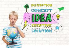 Boy holding world globe with colorful creative concept idea graphics Royalty Free Stock Image