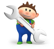 Boy holding a wrench Royalty Free Stock Photos