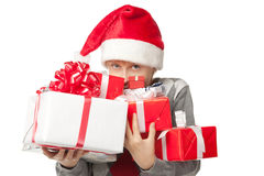 Boy holding Xmas gifts Royalty Free Stock Photo