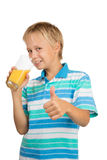 Boy Holdng Glass With Orange Juice Showing Thumb Up Stock Photography