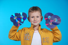 The boy holds 6 CD royalty free stock photo
