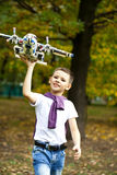 Boy holds airframe. Portrait of a pretty brunette little Boy holds plastic model airplane in autumn park Royalty Free Stock Photos
