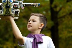 Boy holds airframe. Portrait of a pretty brunette little Boy holds plastic model airplane in autumn park Royalty Free Stock Images