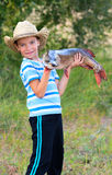 Boy holds big fish. Boy holds big pike he just caught royalty free stock image