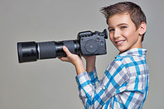 Boy holds big photo camera Stock Photos