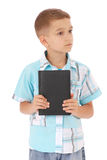 The boy holds the black book Royalty Free Stock Images
