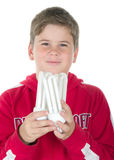 Boy holds a bulb. On a white background Royalty Free Stock Photography