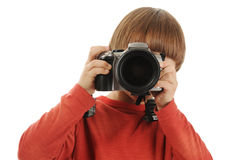 Boy holds a camera Royalty Free Stock Images