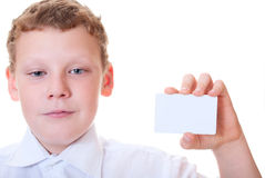 Boy holds the card in the hands of. Boy holds a card in hand on white background Royalty Free Stock Images