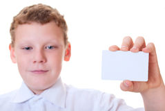 Boy holds the card in the hands of. Boy holds a card in hand on white background Stock Photo