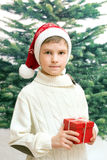 The boy holds christmas present Stock Photo
