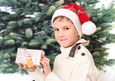The boy holds christmas present in white box Royalty Free Stock Images