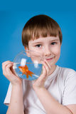 Boy holds a fishbowl with a goldfish Royalty Free Stock Photos