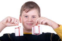 Boy holds gifts. On  white background Royalty Free Stock Images