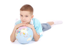 The boy holds the globe in hands Royalty Free Stock Photos
