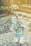 Boy Holds a Green Easter Egg - Retro Stock Image