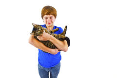 Boy holds his tabby cat in his arms Stock Photography