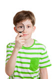 The boy holds loupe opposite his eye Stock Image