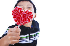 Boy holds love lollipop Royalty Free Stock Photo