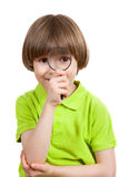 The boy holds magnifying glass Royalty Free Stock Images