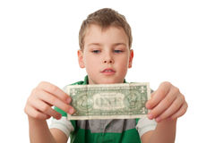 Boy holds one dollar in both hands  isolated Royalty Free Stock Photography
