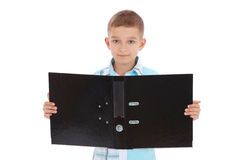 The boy holds the opened black folder Stock Images