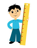 The boy holds a ruler Royalty Free Stock Images