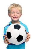 Boy holds soccer ball Stock Images