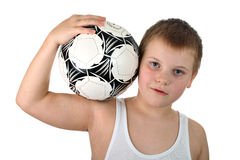 Boy holds soccer ball on shoulder isolate on white Royalty Free Stock Images