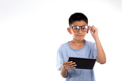 Boy holds tablet. Stock Photography