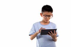 Boy holds tablet stock photography