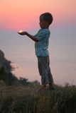 Boy Holds The Sun In Hands Royalty Free Stock Photo