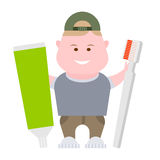 Boy holds toothpaste and toothbrush Stock Images