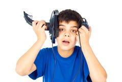 Boy holds two joysticks Royalty Free Stock Image