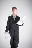 Boy holds two packages of papers Stock Photography
