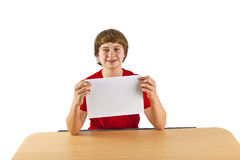 A boy holds up a sheet of paper Royalty Free Stock Photography