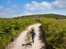Boy on holiday running for joy Stock Photos