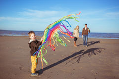 A boy is hollding a kite in his hands Stock Photo