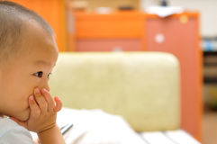 Boy in home. A chinese boy is watching TV in home Royalty Free Stock Images