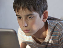 Boy and home computer Royalty Free Stock Photography