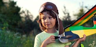 Boy with homemade radio-controlled model aircraft. Airplane is hand made not copyright stock image