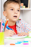 Boy homework at table Stock Images