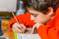 Boy on homeworks Royalty Free Stock Photography
